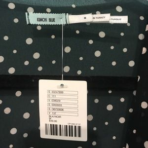 4df039e43ef Urban Outfitters Tops - UO Kimchi Blue Polka Dot Tie Front Top